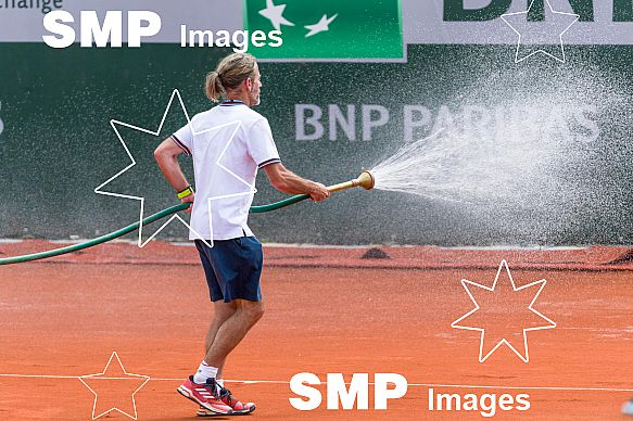 Ground Staff waters the clay court at French Open 2018